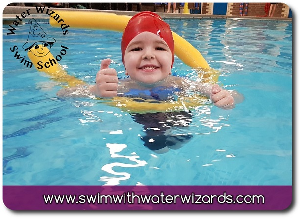 Happy swimmer learning to swim