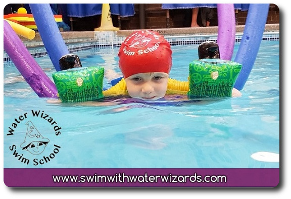 kid smiling while learning to swim in Northampton