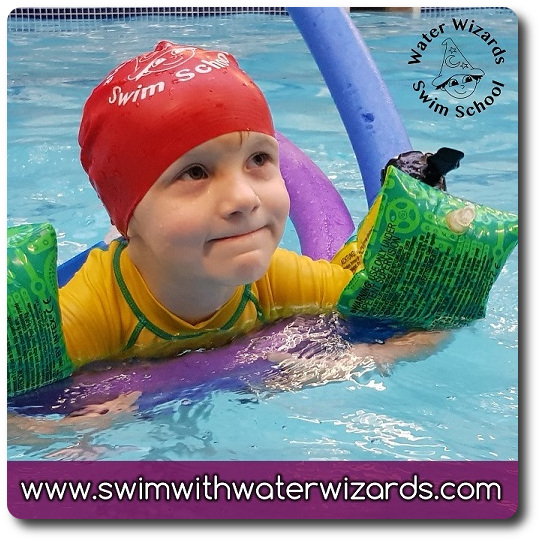 Swimmer smiling while attending swimming lessons in Northampton.